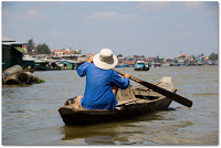Man rowing in Kompong Chhnang