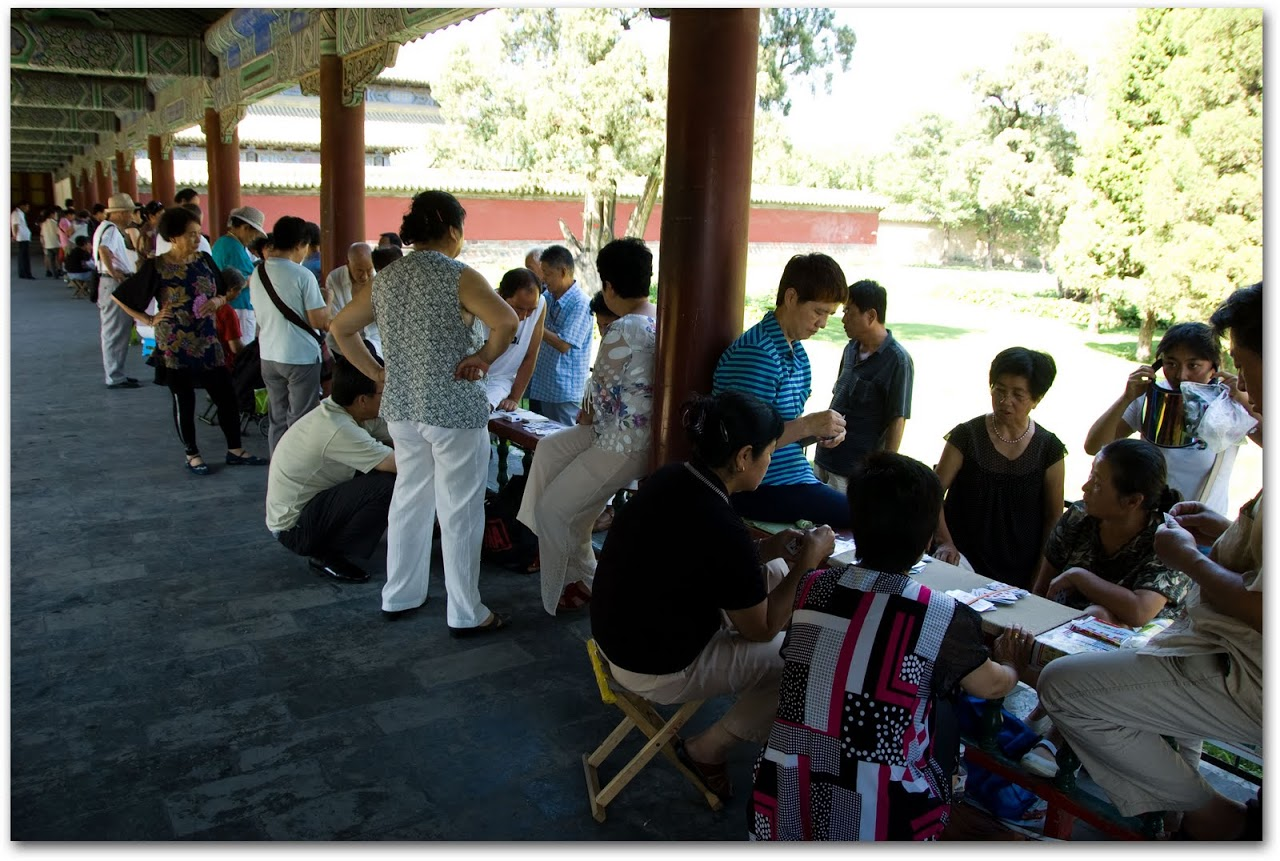 People playing cards at the Temple of Heaven