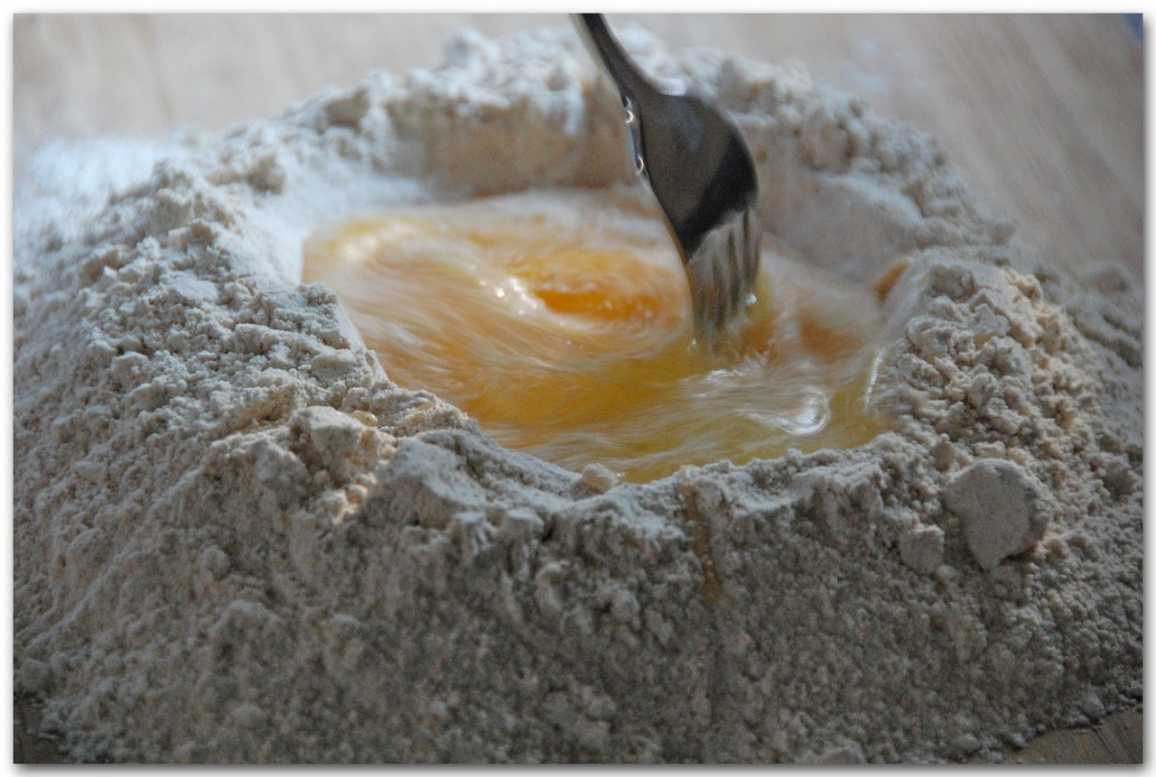 Eggs in flour mound stirred